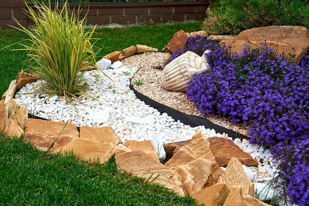 Sandstones, White Rocks and purple flowers - front yard landscaping