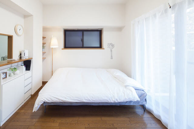 White King Bed with Wooden Floating Shelves - Guest Bedroom Ideas