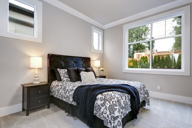 Tufted Dark Brown Bed with Patterned Bedding Set - Guest Bedroom Ideas