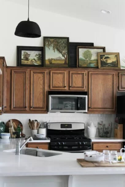 Creating an Art Gallery - above kitchen cabinet decor
