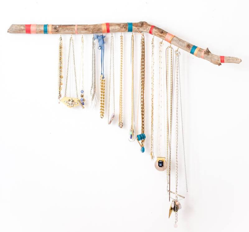 DIY hanging branch jewelry display and organizer