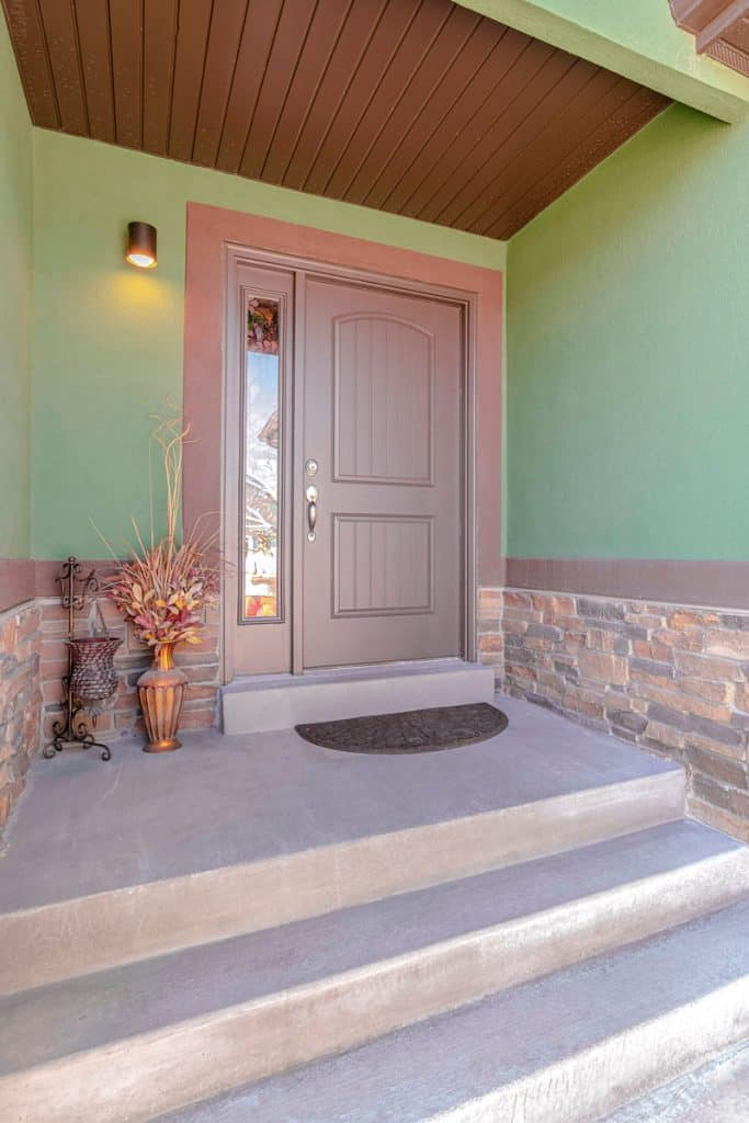 Cherry Brown Front Door Color for Green House