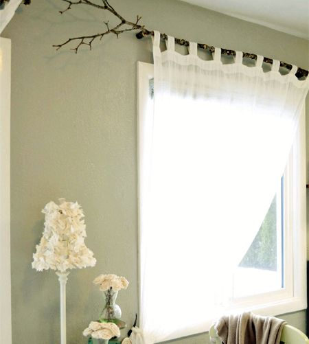 wooden tree branch for hanging curtains