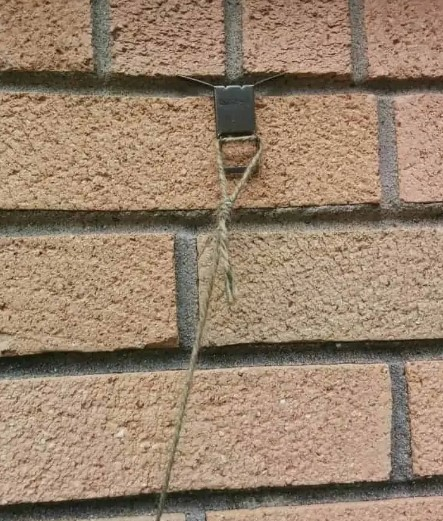 how to hang things on brick walls without drilling