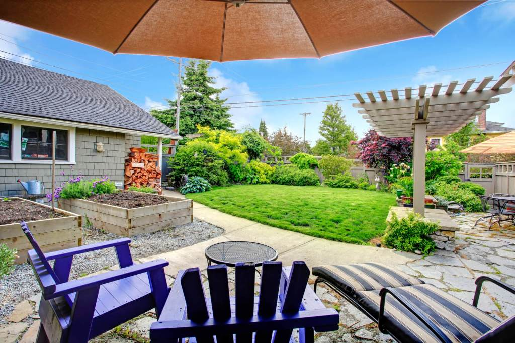 Pergola and Grass - Backyard lanscaping ideas on a budget