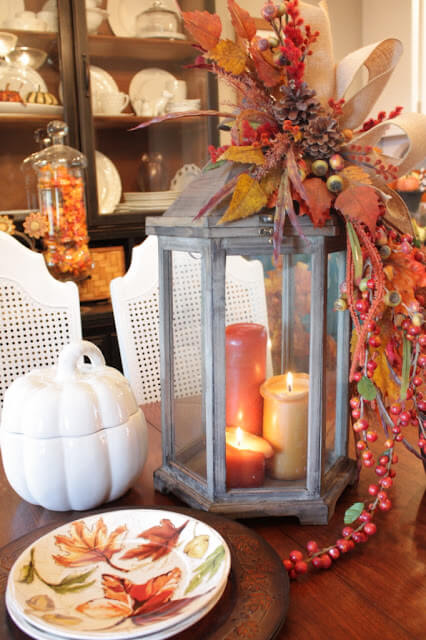 Candle lantern garnished