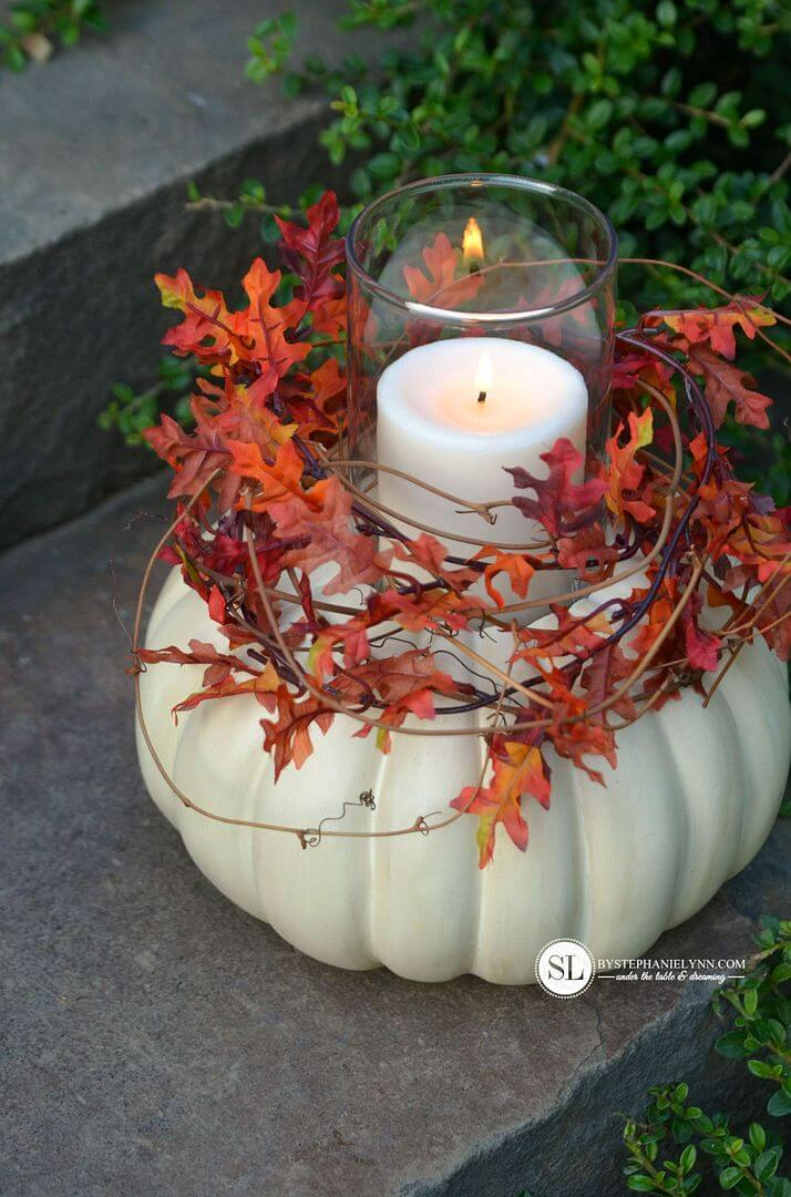 Painted pumpkins as candle holders