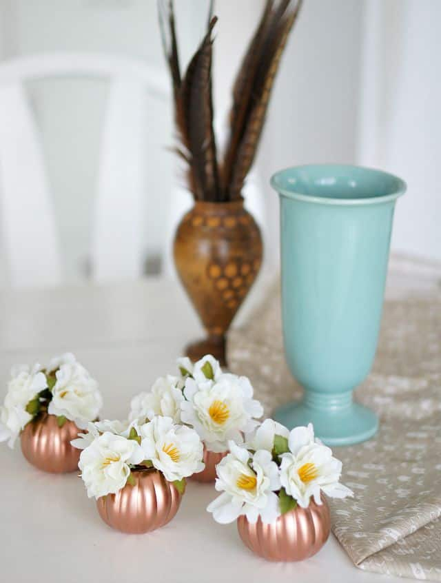 Floral pumpkins - copper-pumpkins-table