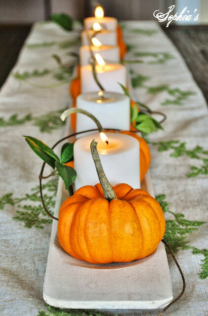 Pumpkin, candle, repeat - pumpkins and candle centerpiece